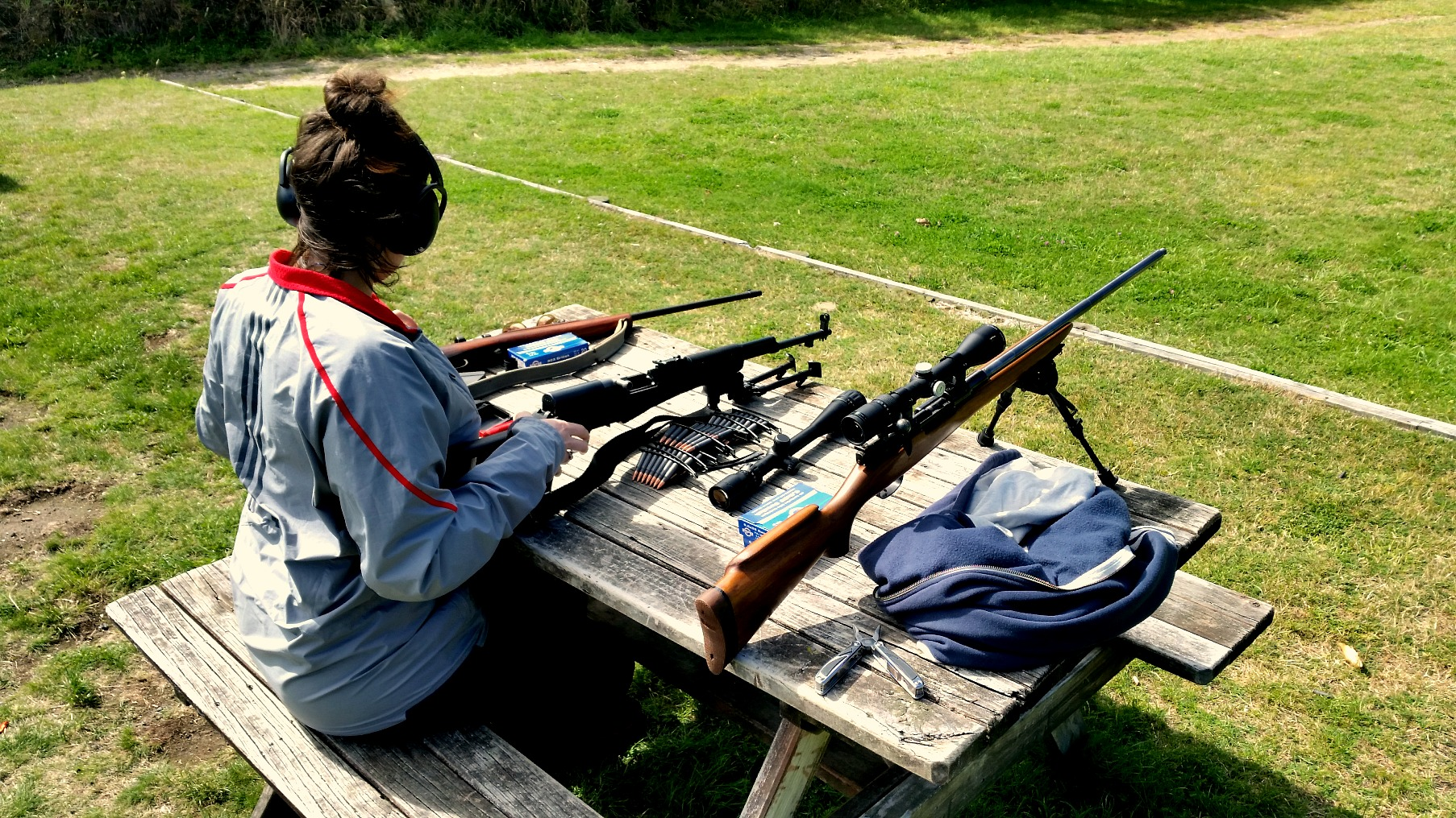 My wife with .303, SKS and M38 at Taupo NZDA.
