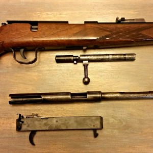 The Wischo rifle sporting the Voere sight, pictured next to the Voere bolt, action/barrel and trigger group.