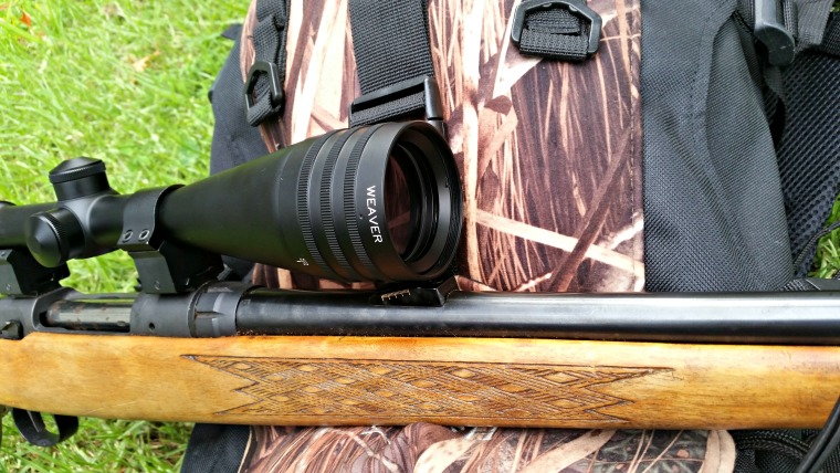 The objective bell clears the rear sight on this Savage nicely.