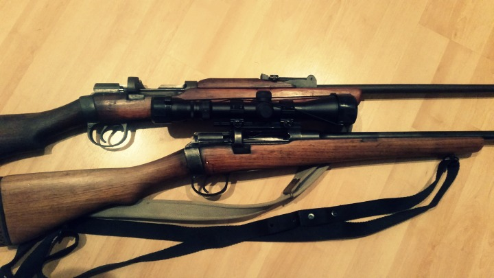 Comparing two SMLEs, one with original fixed sights and one with a scope mounted and iron sights removed.