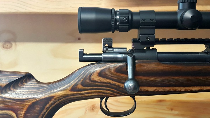 Lift the safety lever into the upright position and remove the bolt without lowering the safety. You may need to remove your scope if the safety won't clear it.